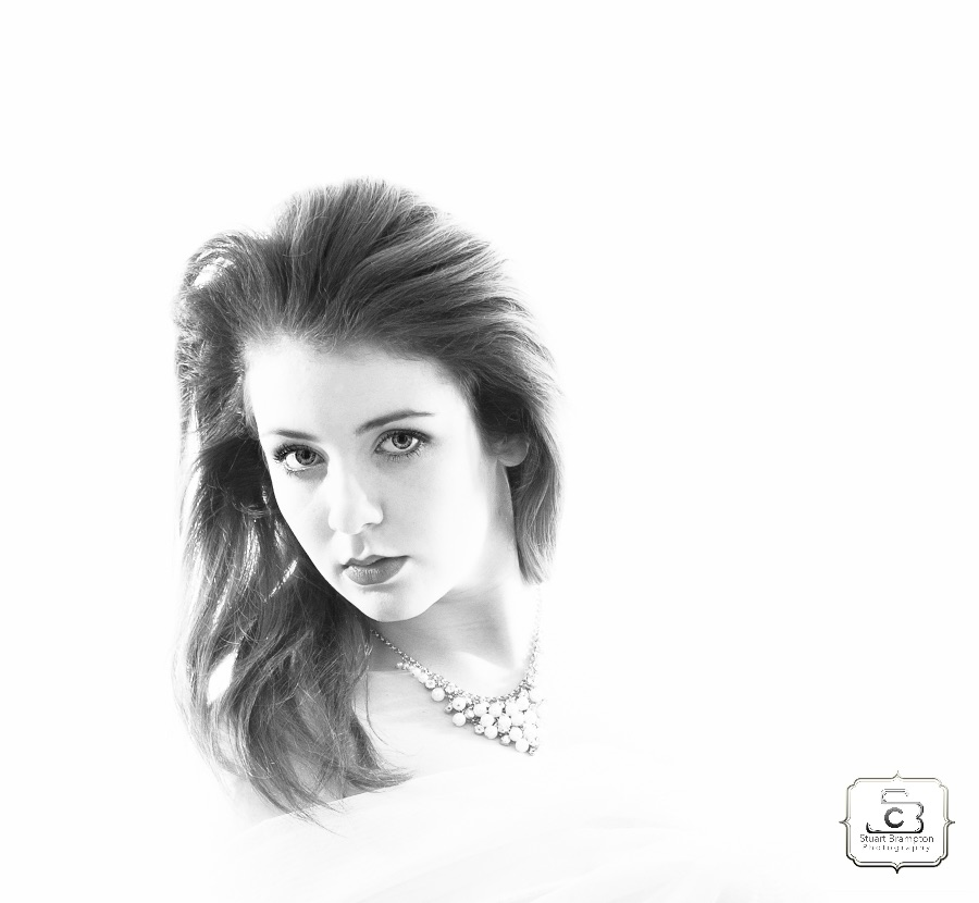 I simply set the lighting to over expose the background and used a simple beauty dish with silver defector set just above and to the left of the models eye